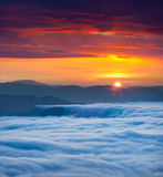 Sunrise over the sea of fog in the mountains Stock Image