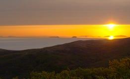 Sunrise over sea. Islands Stock Image