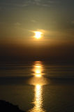 Sunrise over the sea with a long and wide sunny lane Stock Photography