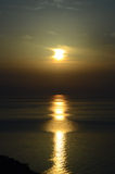 Sunrise over the sea with a long and wide sunny lane Stock Photo