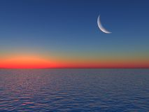 Sunrise over Sea with Moon Stock Photography