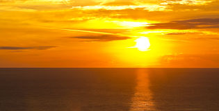 Sunrise over the sea. Red sun rising over the sea Royalty Free Stock Photography