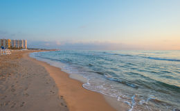 Sunrise over sea and sand beach Royalty Free Stock Images