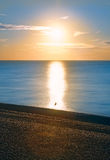 Sunrise Over Sea and Shale Royalty Free Stock Photos