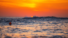 Sunrise over sea. Sunrise and shining waves in ocean Stock Photos
