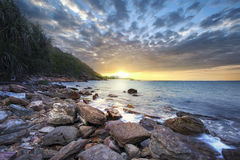 Sunrise over the sea. Stone on the foreground Stock Images
