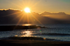 Sunrise over the sea, sun over the clouds in the morning Stock Photos