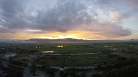 Sunrise time-lapse over the Shan Hills from Mandalay, Myanmar. A September sunrise over the rice paddies between Mandalay and the Shan Hills stock video footage