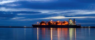 LNG TANKER AT THE GAS TERMINAL royalty free stock images