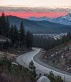 Sunrise over the Sierra Nevada as seen from a curvy road stock image