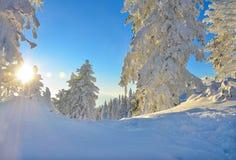 Sunrise over ski slope Royalty Free Stock Image