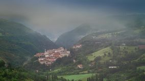 Sunrise over small village in mountains at spring, Italy stock footage