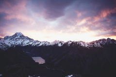 Sunrise over snow capped mountains Royalty Free Stock Photos