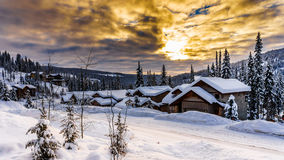 Sunrise over Snow Covered Village Stock Images