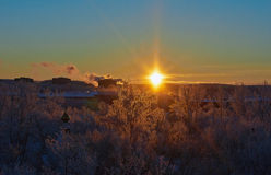 Sunrise over the snow-covered winter town. Royalty Free Stock Photography