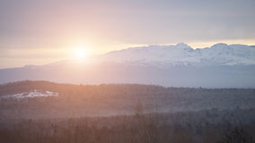 Sunrise over snow mountain Royalty Free Stock Images