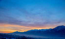 Sunrise over snow Tatry mountains. In winter time royalty free stock photo