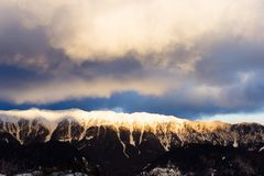 Sunrise over a snowy mountain peak. Royalty Free Stock Photos