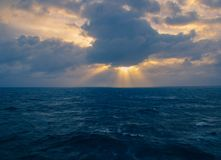 Sunrise over the Southern Ocean. Off the coast of Africa on a cloudy, moody morning, image in landscape format with copy space Royalty Free Stock Photos