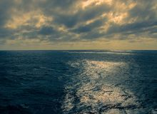 Sunrise over the Southern Ocean. Off the coast of Africa on a cloudy, moody morning, image in landscape format with copy space Royalty Free Stock Photography