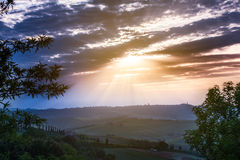 Sunrise over a spring landscape of Tuscany fields, Italy Royalty Free Stock Image