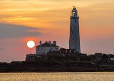Sunrise over St Marys Lighthouse Stock Photo