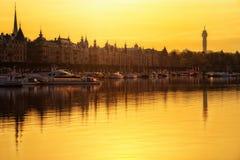 Sunrise over Stockholm, Sweden. Sunrise over Strandvagen with boats on calm water, Stockholm, Sweden Royalty Free Stock Images