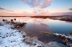 Sunrise over swamp. In winter Stock Photo