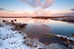 Sunrise over swamp Stock Photo