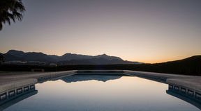 Sunrise over swimming pool Stock Image