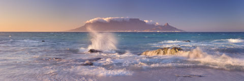 Sunrise over the Table Mountain and Cape Town. From the beach of Bloubergstrand royalty free stock photo