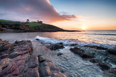 Sunrise over Talland Bay in Cornwall Stock Photos