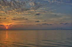 Sunrise over Tampa bay. And the Sunshine Skyway Bridge Stock Images