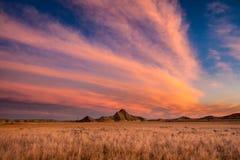 Sunrise over Toadstool State Park, Nebraska. The sunrise casts beautiful colors across the sky and landscape surrounding Toadstool State Park in Northwestern stock photo