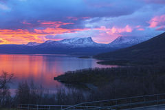 Sunrise over Torne träsk and U-shaped mountain named Lapporten Stock Photos