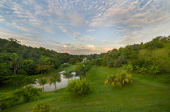 Sunrise over tropical farm with pond and dramatic sky. Sunrise over a tropical farm in Puerto Rico with a pond and a dramatic colorful sky stock photography