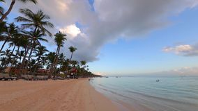 Exotic island and beautiful sunrise on the beach. Morning in Punta Cana, Dominican Republic. Sunrise over tropical island beach and palm trees. Punta Cana stock video footage