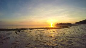 Sunrise over the tropical sea. Timelaps. stock video footage