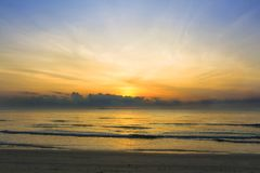 Sunrise over the tropical seacoast beach. The wave of seawater u. P the beach and waves slowly splashing on the sand. with copy space for your text Stock Photos