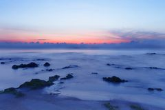 Sunrise over the tropical seacoast beach. The wave of seawater u. P the beach and waves slowly splashing on the sand. with copy space for your text Royalty Free Stock Images