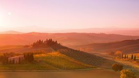 Sunrise over Tuscan Hills. Time Lapse 4K. Italy. Tuscany. Fields, vineyards, olive orchards and Appennino mountains in the background. Sunrise. Time lapse 4K stock video