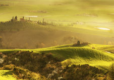 Sunrise over Tuscany. A picture taken in early spring, in Val dOrcia, Tuscany, at sunrise Stock Image