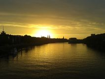 Sunrise over urban river Stock Photo