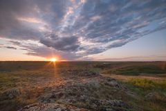 Sunrise over valley with clouds. And sun, spring landscape Royalty Free Stock Photography