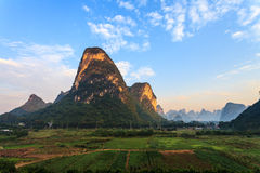 Sunrise over a valley of limestone hills Royalty Free Stock Photography