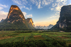Sunrise over a valley of limestone hills Royalty Free Stock Photos