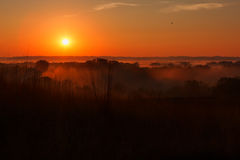 Sunrise over the Valley. The sun comes up over the Minnesota River Wildlife Refuge Royalty Free Stock Photo