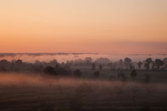 Sunrise over the valley, the sun rises above the horizon, the warm sunshine Royalty Free Stock Photos