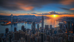 Sunrise over Victoria Harbor as viewed atop Victoria Peak. With Hong kong and Kowloon below royalty free stock photos