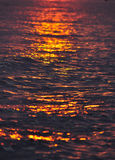 Sunrise over water Royalty Free Stock Photos